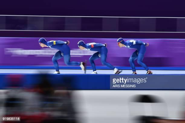 South Korea's Kim Min Seok South Korea's Chung Jaewon and South Korea's Lee SeungHoon compete in the men's team pursuit quarterfinal speed skating...