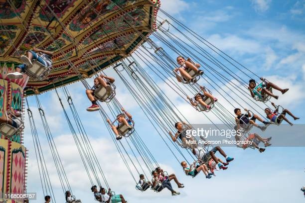 front view chained chair spin ride at wisconsin state fair - festival of remembrance 2019 stock photos and pictures