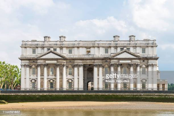 front view from the thames river of a building belonging to the old royal naval college at greenwich district, city of london, england, uk. - greenwich london stock pictures, royalty-free photos & images
