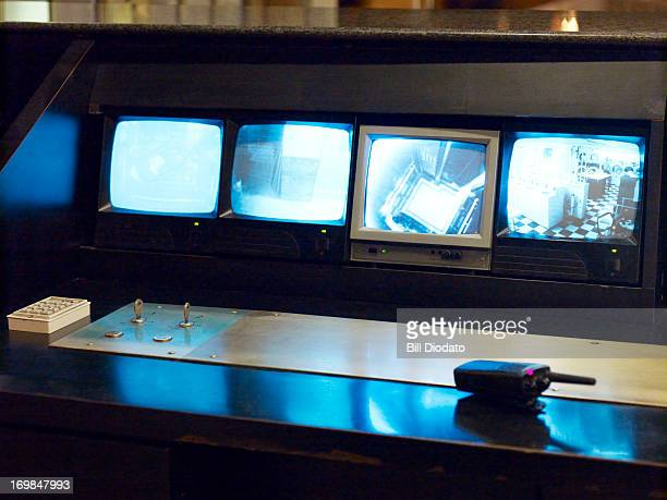 front view of 4 security monitors