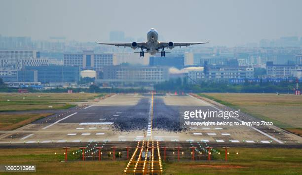 front view of a airplane taking off from runway