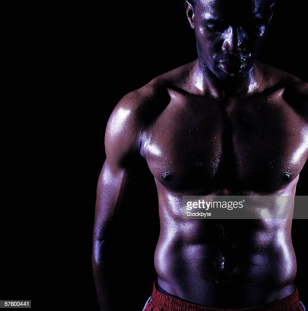 front view of a bare-chested muscular young man - chest barechested bare chested stock-fotos und bilder