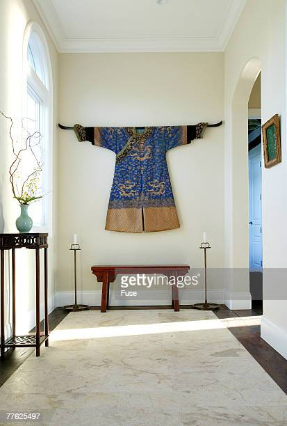 Front view of a blue dress hung on a wall