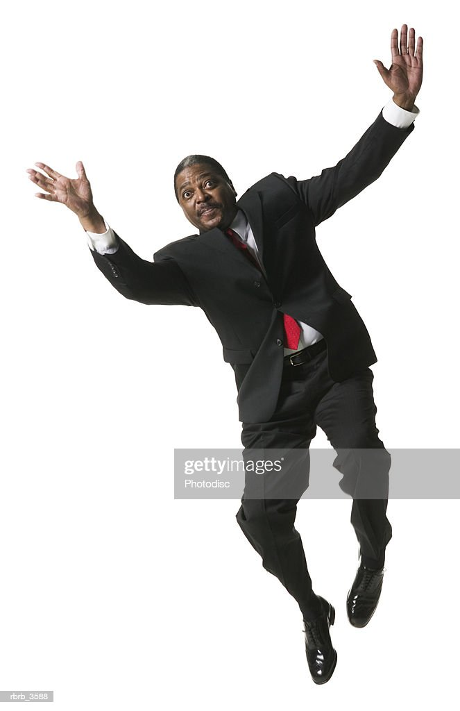 Front view of a businessman jumping : Foto de stock