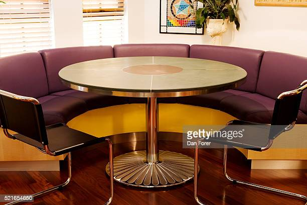 Front view of a circular metal table arranged near a stylish couch