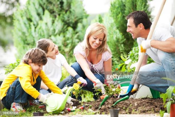 Front view of a family gardening together.