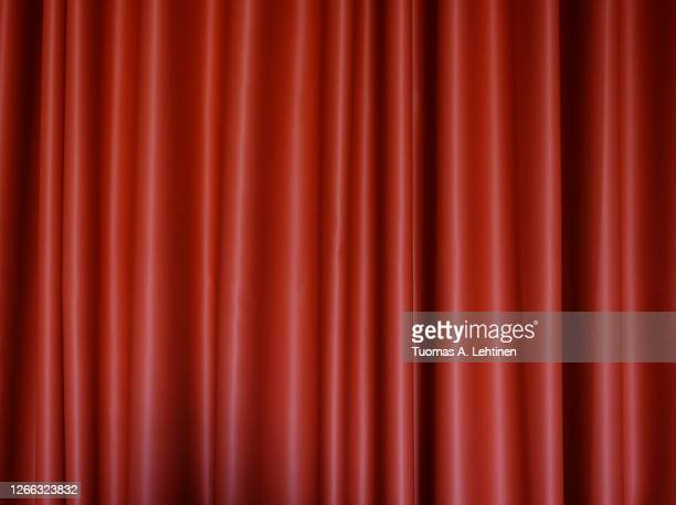 front view of a folded red polyester curtain. - ドレープ ストックフォトと画像