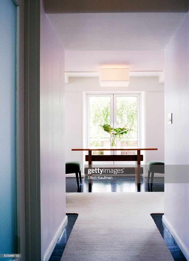 front view of a hallway leading to the dining table placed in the