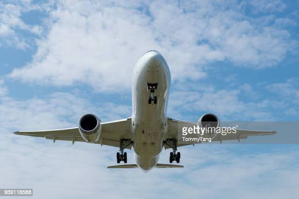 front view of  a landing airplane. - taking off stock pictures, royalty-free photos & images