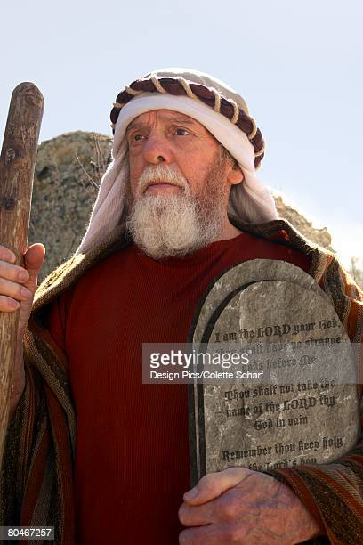 Front view of a senior man holding cane and the 10 commandments