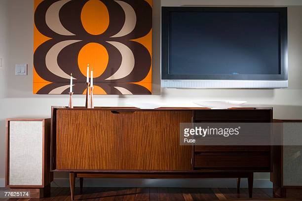 front view of a television beside a painting - mismatched clothes stock pictures, royalty-free photos & images