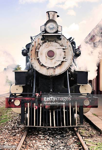 Front view of active steam engine locomotive