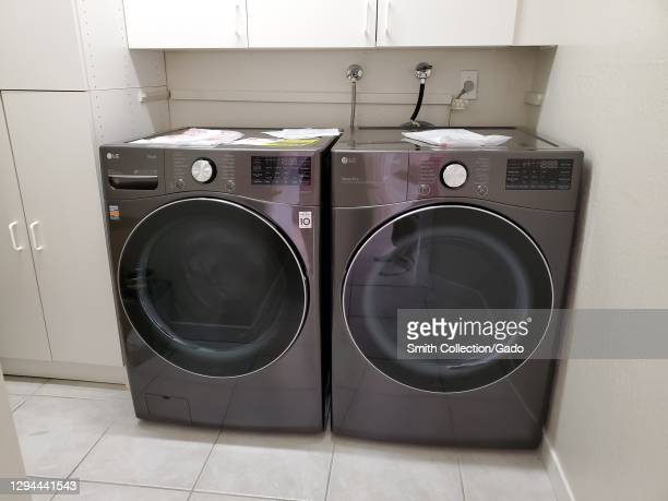 Front view of an LG washing machine and dryer side by side in a laundry room in San Ramon, California, December, 2020.