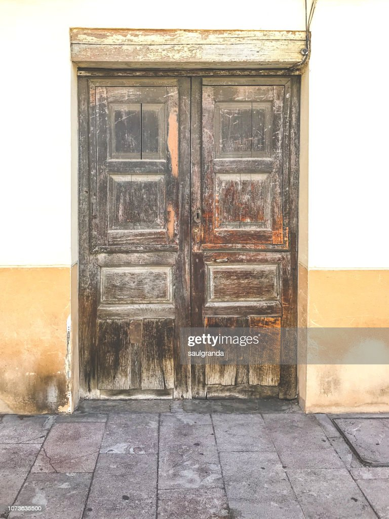 Front view of an old wooden door : Stock Photo