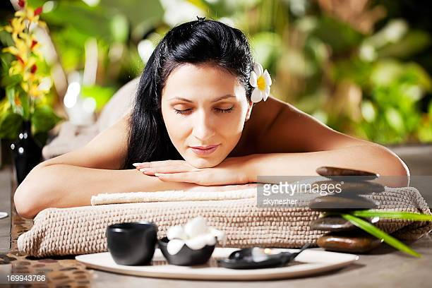 Front view of beautiful girl resting in spa center.