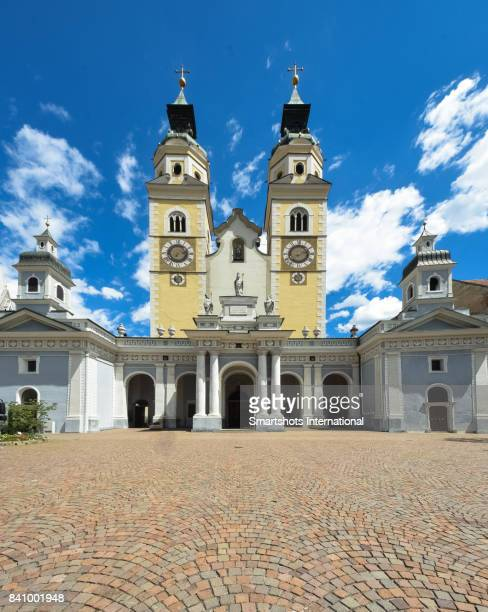 Front view of Brixen cathedral facade with twin bell towers in South Tyrol, Italy