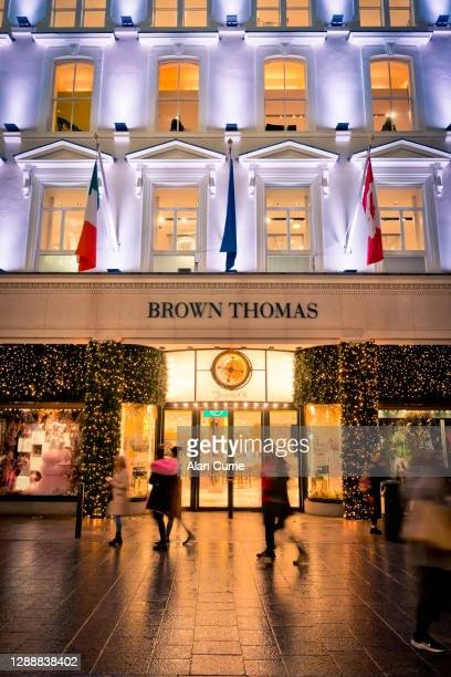 front view of brown thomas store at christmas in dublin at night - brown thomas christmas stock pictures, royalty-free photos & images