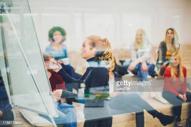 front view of business people attending a seminar in board room - social media marketing stock pictures, royalty-free photos & images