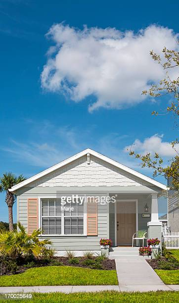 front view of cottage house on sunny day - small stock pictures, royalty-free photos & images