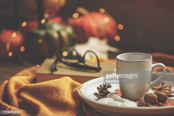 front view of cup of hot beverage with small bites on the plate - embellishment stock pictures, royalty-free photos & images