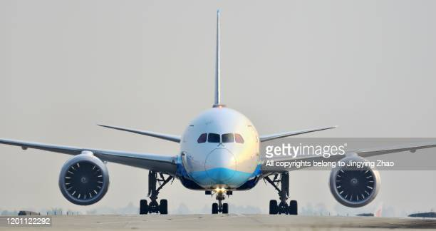 front view of different types of aircrafts moving on runway - taxiway stock pictures, royalty-free photos & images
