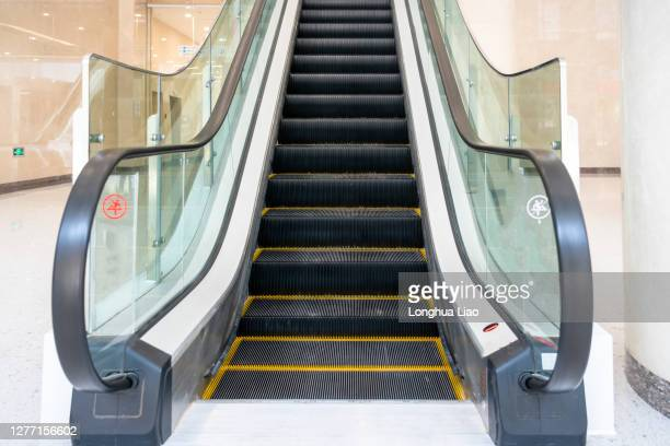 front view of escalator - staircase stock pictures, royalty-free photos & images