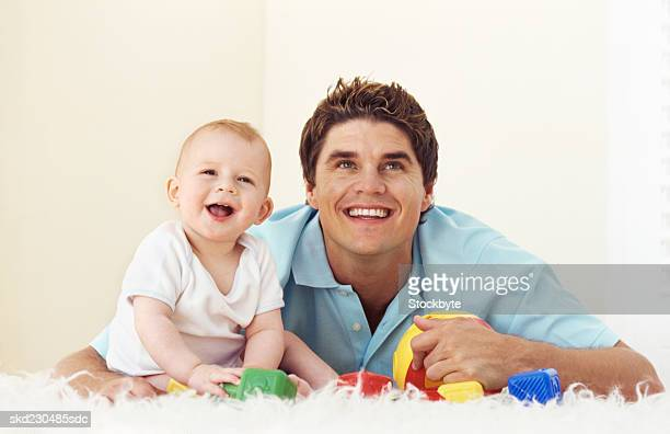 Front view of father playing with baby boy (6-12 months)