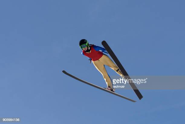 Front View of Female Ski Jumper in Mid-air