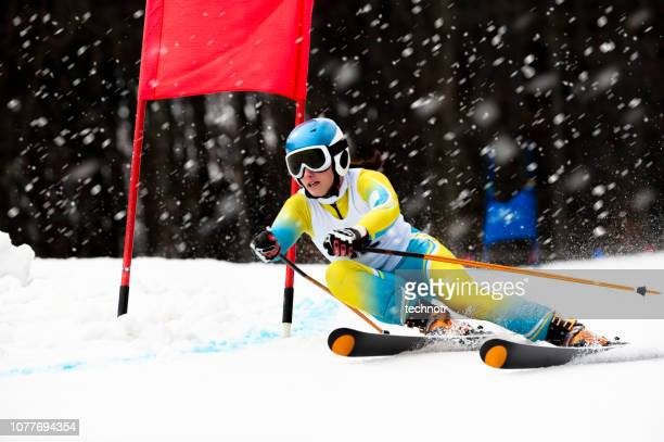 front view of female skier at giant slalom ski practice during snowing - winter sport stock pictures, royalty-free photos & images