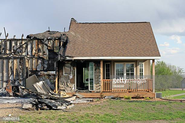 front view of fire damaged home - burnt stock pictures, royalty-free photos & images