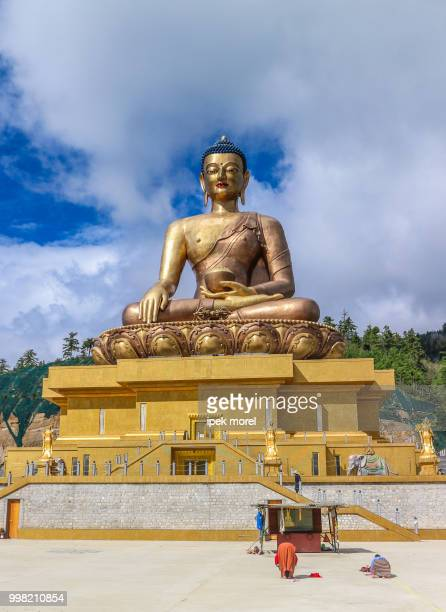 front view of giant buddha dordenma statue with the blue sky and - ipek morel stock pictures, royalty-free photos & images