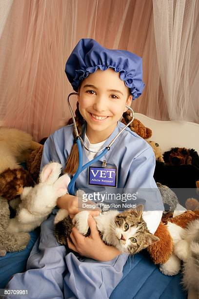 Front view of girl holding cat