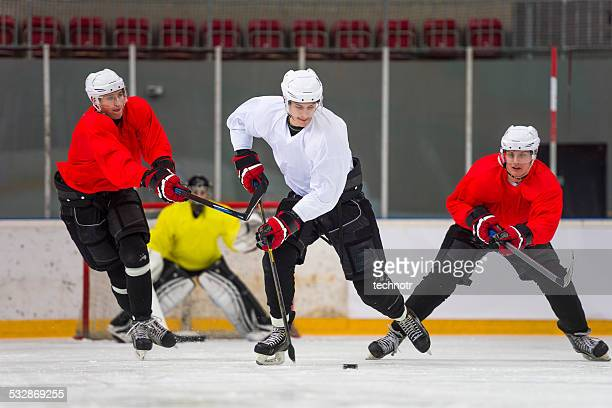 front view of ice hockey players in the action - ice hockey player stock pictures, royalty-free photos & images