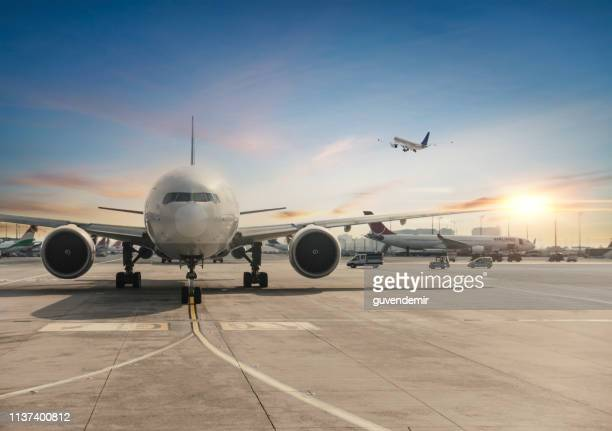 front view of landed airplane in istanbul international airport - aeroplane stock pictures, royalty-free photos & images