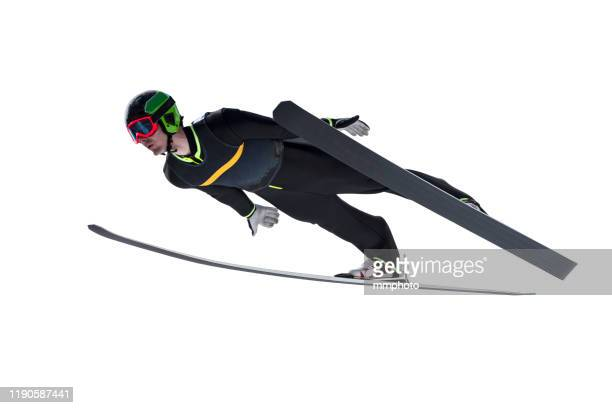 front view of male ski jumper in mid-air, isolated on white - winter sport stock pictures, royalty-free photos & images