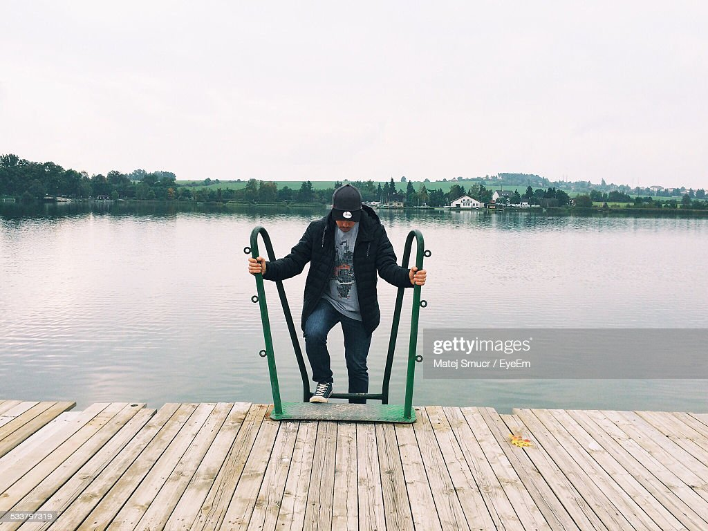 Front View Of Man On Pier Against Clear Sky : Foto stock