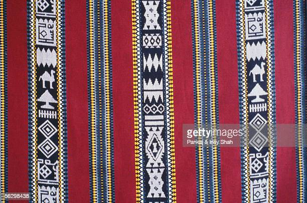 front view of red designed fabric. - majlis stock pictures, royalty-free photos & images