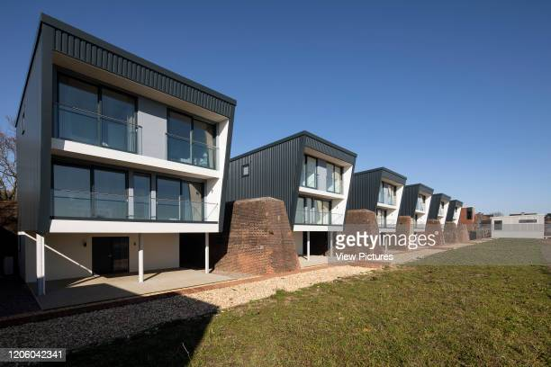 Front view of row of houses from one end. Priddys Hard, Gosport, United Kingdom. Architect: John Pardey Architects, 2019.