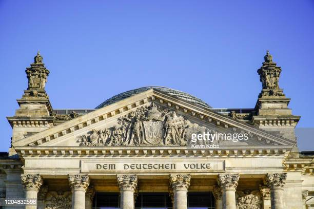 front view of the reichstag building's gable in berlin, germany. - kuppel stock-fotos und bilder