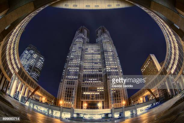 front view of the tokyo metropolitan government building (city hall) at night - 東京都庁舎 ストックフォトと画像