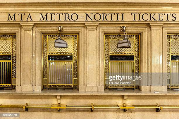 Front view of Ticket counter row made of brown marble and brass in Grand Central Terminal Manhattan