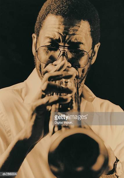 front view of trumpet player - トランペット奏者 ストックフォトと画像