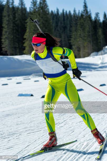 Front View of Young Female Biathlon Competitor Training