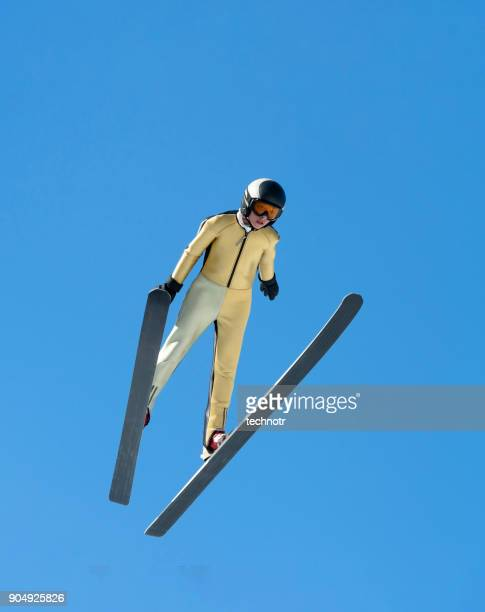 Front View of Young Male Ski Jumper Practicing at 30 m Hill