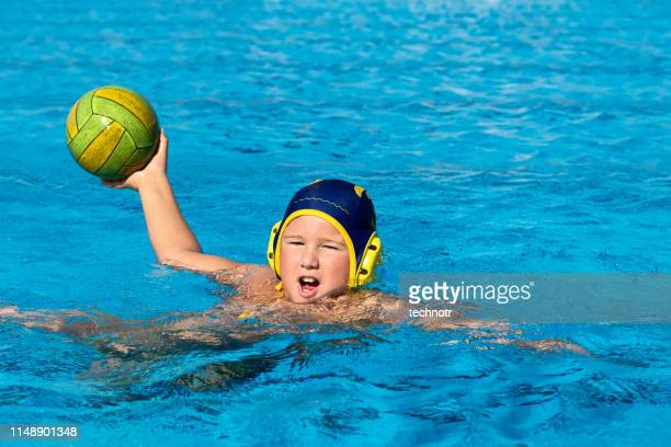 front view of young water polo player practicing - water polo stock pictures, royalty-free photos & images
