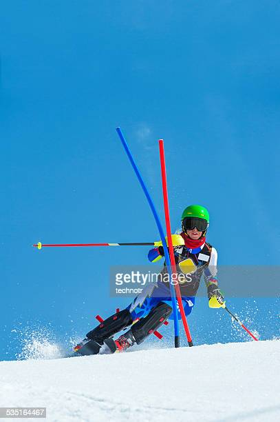 front view of young women during the slalom ski race - ski racing stock pictures, royalty-free photos & images