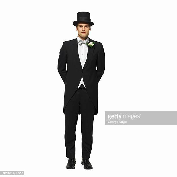 front view portrait of a groom wearing his top hat