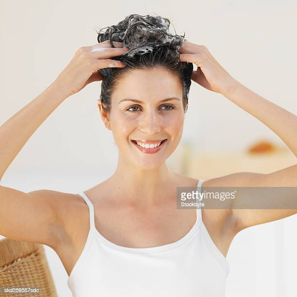 Front view portrait of a woman washing her hair