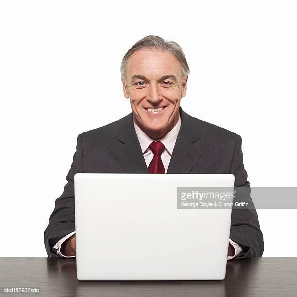 Front view portrait of businessman working laptop