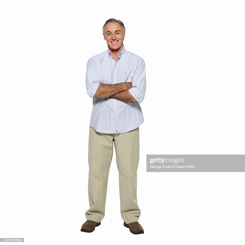 Front view portrait of mature man with arms crossed : Stock Photo